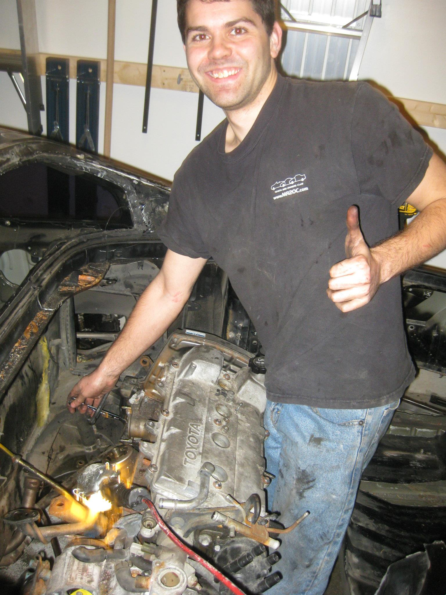 A picture of Bill working on a car